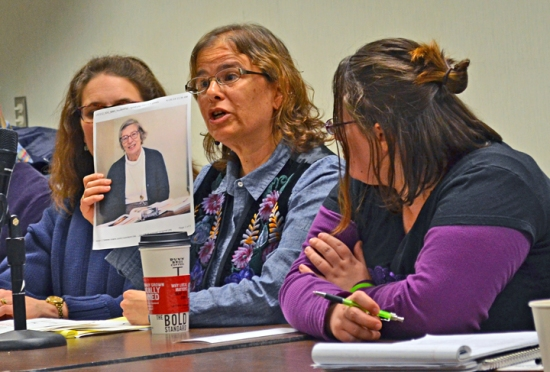 Anne Winkler-Morey holds a picture of Mary Vojtko, the late adjunct professor at Duquesne University whose death last year drew national attention to declining wages, hours and benefits for adjuncts nationwide.