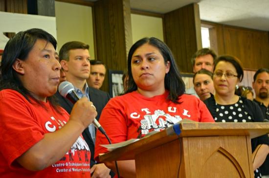 Lucilla Dominguez (L) speaks at a press conference during CTUL's victory celebration. Veronica Mendez translates.