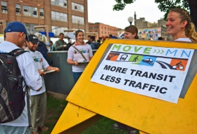 Abby Tomasek wore a cardboard light-rail costume to the ribbon cutting. She and other activists used the event as an opportunity to sign transit-users up for MoveMN, an advocacy group pushing broad investments in the state's transportation infrastructure.