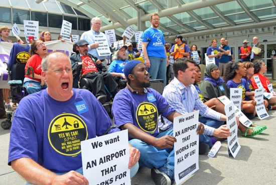 Demonstrators block traffic outside Minneapolis-St. Paul International Airport, protesting low wages and poor conditions for workers who provide services to travelers with disabilities.