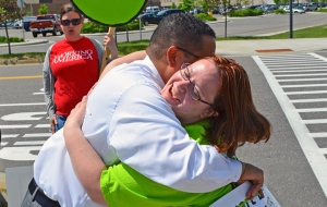 U.S. Rep Keith Ellison hugs Cantare Davunt, who walked out of her job at Walmart in Apple Valley to join the OUR Walmart strike.
