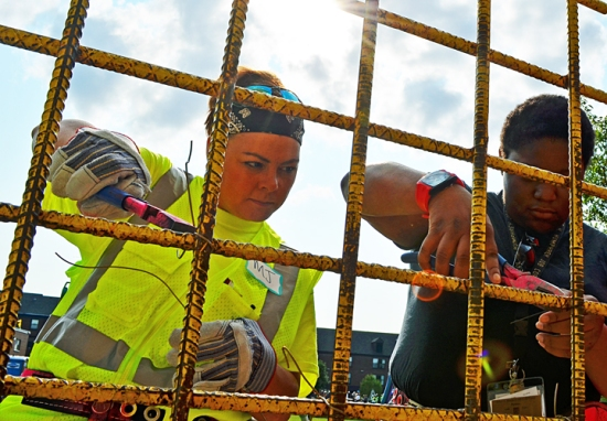 Ravinia Walker (R), a 21-year-old from St. Paul, watched as M.J. Fackler, a second-year apprentice with Ironworkers Local 512, demonstrated different methods of using wire to tie rebar together.