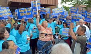 U.S. Rep. Keith Ellison (R) leads a rally outside the Social Security office in Minneapolis, which has reduced its service hours.