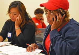Linda Yang (L) and Diana Hill, both members of CWA Local 7250, put their skills into action during a phone bank at the Labor 2014 campaign school in St. Paul.