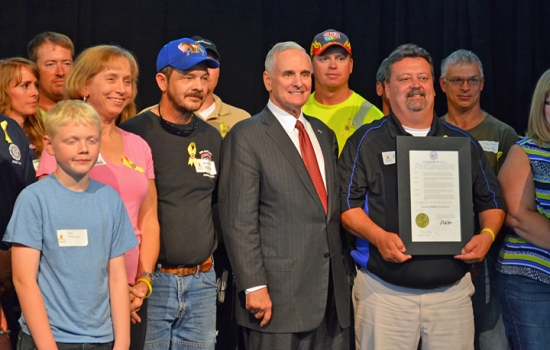 Veterans and their families who work at McGough join Gov. Mark Dayton during the Yellow Ribbon Company proclamation ceremony.