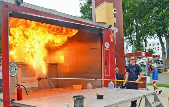 St. Paul Firefighter Dominic Novak, a member of Fire Fighters Local 21, demonstrates how not to put out a grease fire at the Labor Pavilion.