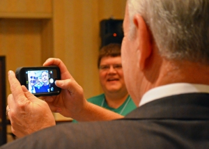 Gov. Mark Dayton poses for a selfie with a delegate to the AFSCME Council 5 convention.