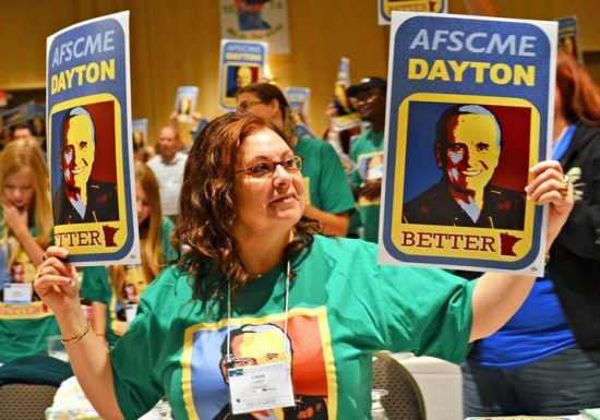 Delegates cheer Gov. Mark Dayton's arrival on the floor of the AFSCME Council 5 convention.
