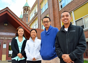 Fourth-grade teacher Bong Xiong, second from right, was active in efforts to organize a staff union at CSE. He was fired over the winter break.