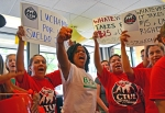 Striking workers rally inside a McDonald's in Uptown Minneapolis.