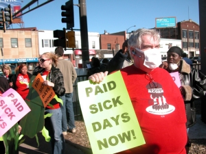 Activists in St. Paul rallied in 2008 in support of expanding workers' access to paid sick time.