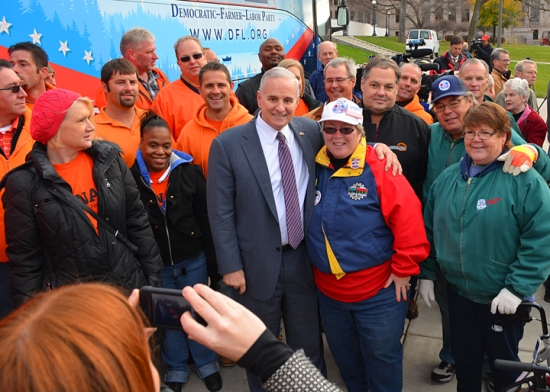 After the rally, labor-endorsed Gov. Mark Dayton posed for photos with union volunteers like retired Machinist Mary Sansom.