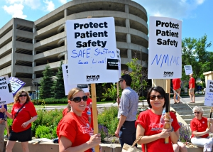 Union nurses and health care workers picketed outside North Memorial June 26.