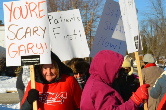 Nurses stage informational picketing outside Cambridge Medical Center, raising awareness of staffing cuts that, nurses say, threaten patient safety.