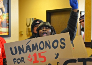 Striking fast food workers are demanding $15 per hour and union rights.