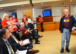"""Fired Delta worker Kip Hedges speaks during the open forum portion of the MAC meeting. """"I can assure everyone here that I, for sure, am not going to stop doing what I'm doing,"""" he said."""
