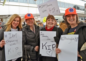 Pro-union Delta flight attendants based at Minneapolis-St. Paul International Airport joined a rally last month in support of fired Delta baggage handler Kip Hedges: (L to R) Julianna Helminski, Laurie Gandrud, Dotty Malinsky and Tammy Rustad.