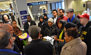 Airserv workers deliver a petition to a representative of the Metropolitan Airports Commission.
