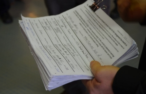 A petition signed by 225 workers calls on Airserv to provide hard copies of workers' paycheck stubs.