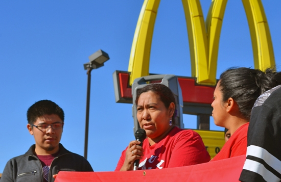 """Outside the McDonald's where she works, Blanca Gonzalez explains her decision to join the April 15 strike: """"We deserve more for the work we do."""""""