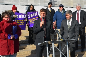 Rep. Denny McNamara offers support for SEIU home care workers like Rosemary Van Vickle (red coat), who are pushing lawmakers to OK their tentative contract agreement with the state.
