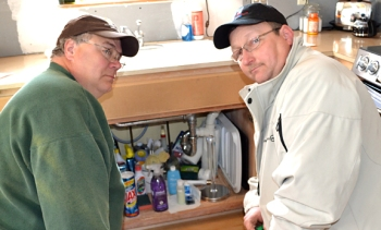 Local 34 members Gerald Keating (L) and Brett Sergot volunteered together during the Water's Off day of service March 21.