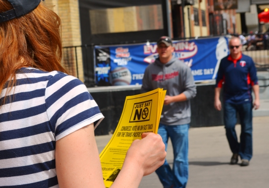 Fair trade activists handed out fliers outside Target Field Saturday.