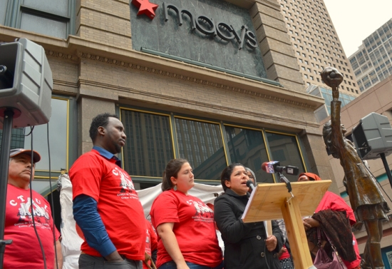 CTUL member Maricela Flores speaks at a press conference announcing a class-action lawsuit seeking unpaid wages for workers who cleaned Macy's and Herberger's stores in the Twin Cities.