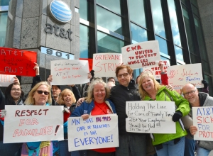 CWA Local 7250 members picket outside AT&T's offices downtown Minneapolis.