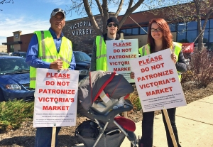 Workers hold informational picketing outside Victoria's Market, formerly Fresh Seasons Market.