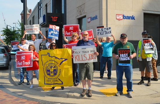 Union members from Minnesota and Wisconsin stand together against Fast Track and the TPP outside Rep. Ron Kind's Eau Claire offices.