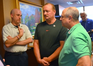 AFSCME Council 5 Executive Director Eliot Seide (R) talks with HealthEast security officers Joe Misencik (L) and Jeff Perry.