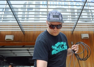 Merritt Benton, a member of IATSE Local 13, runs cords along the Labor Pavilion's stage. Local 13 donated, installed and will run the pavilion's sound and stage.