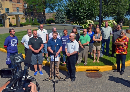 Kyle McGinn speaks at a press conference outside Bethesda Hospital in St. Paul, where he works as a security officer.