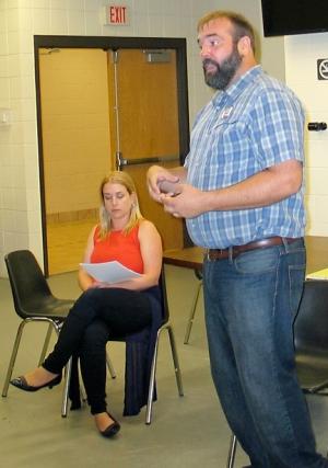 Megan Boldt and Darren Tobolt address union leaders in Duluth. (Labor World photo)