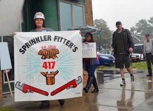 Kimberly Brinkman carriers Sprinklerfitters Local 417's banner outside a Scott Walker appearance in St. Paul.
