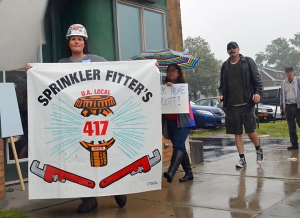 Kimberly Brinkman carriers Sprinklerfitters Local 417's banner outside a Scott Walker appearance in St. Paul.