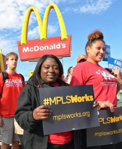 Shenda Kazee joins a rally outside her workplace, the McDonald's in Dinkytown.
