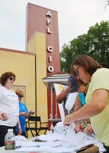 Volunteers Claudia Brau (R) and Debra Madden-Petersen at the Labor Pavilion.