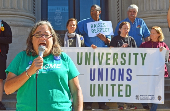 Mary Austin, president of AFSCME Local 3937, reports on negotiations with the U of M during a rally outside Morrill Hall.
