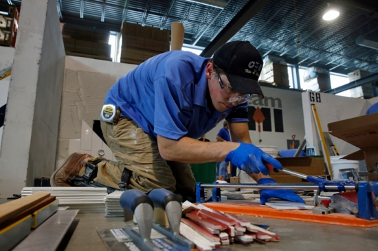 Brandon Peterson competes in the BAC IMI International Apprentice Contest's tiling category. Photo courtesy © BAC/Todd Buchanan 2015