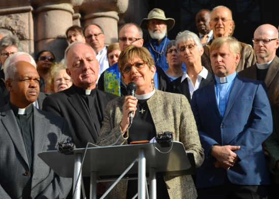 Rev. Laurie Eaton of Our Savior's Lutheran Church in Minneapolis, calls for a policy guaranteeing workers access to earned sick time at a press conference outside Minneapolis City Hall.