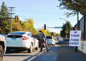 Activists hand out hundreds of fliers on the Hamline Avenue bridge.