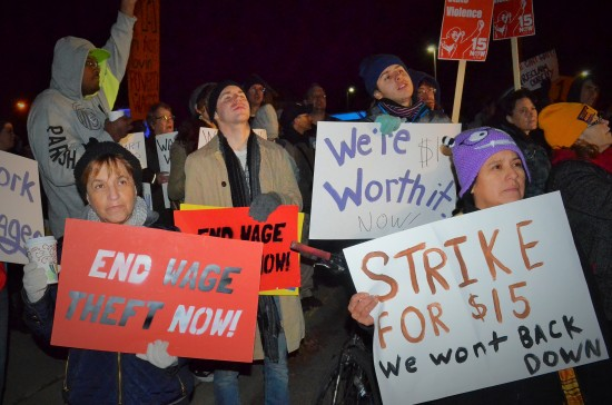 Striking workers and their supporters rally outside a McDonald's and Super America in Northeast Minneapolis.