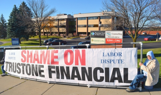 Carpenters call out TruStone outside the credit union's new Burnsville location.