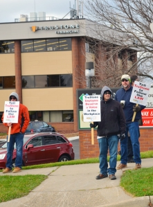 Supporters stage informational picketing outside TruStone's Burnsville branch, which opened with non-union staff two days after TruStone closed a union facility in nearby Apple Valley.
