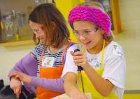 Emma Johnston (L) of Fridley and Skylar Hofer, both 8, share a laugh.
