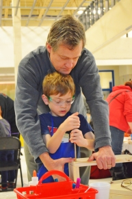 Abe Mulrooney, 7, of St. Paul works with his father, Tim.