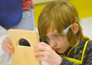 Ten-year-old Aiden Kirchoff of St. Paul sizes up his project.
