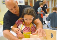 Carpenters staff rep Jose Marrero works with his daughter Elise, 10, of Maplewood.